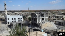 A general view of deserted streets and damaged buildings in the central Syrian town of Talbisah in Homs Province, which was targeted by Russian strikes on September 30.