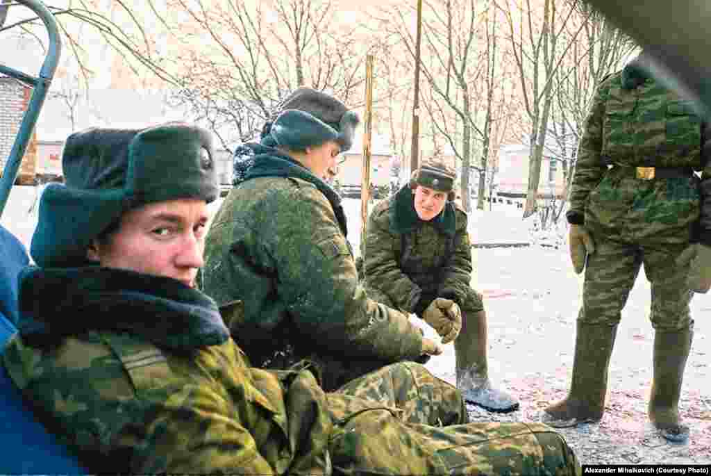 Soldiers take a quick break during the daily snow-clearing.
