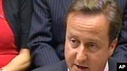 Ұлыбритания премьер-министрі Дэвид Кэмерон парламентте мәлімдеме жасап тұр. Лондон, 11 тамыз 2011 жыл.