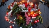 GERMANY - People place candles at central market square in Halle, Germany October 10, 2019, after two people were killed in a shooting