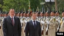 Presidents Ilham Aliyev (left) and Medvedev in Baku on July 3