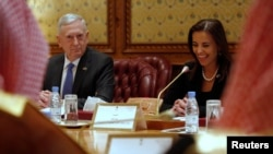 Dina Powell (right), when she was White House deputy national-security adviser, sitting next to U.S. Defense Secretary Jim Mattis.