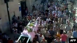 An image grab from a video uploaded on YouTube reportedly shows the funeral of antigovernment demonstrator Ahmad Ibrahim outside Hama on October 10.