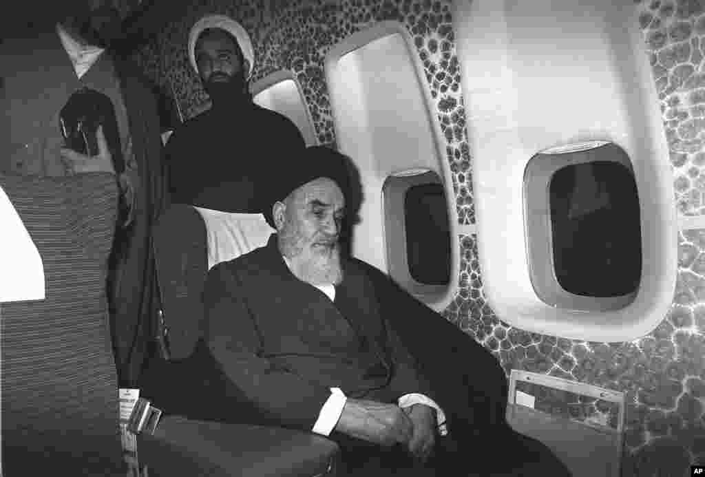 Khomeini sits inside the chartered airplane which was to fly him back to Iran.