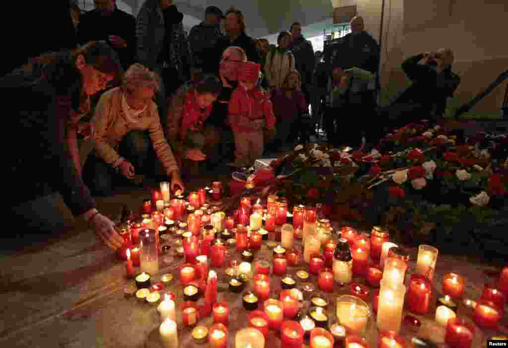 As the Zeman protests took place, others lit candles at the Velvet Revolution memorial. No one was killed in the revolution -- the candles are to commemorate the people killed and imprisoned during the Communist Party's 41-year rule.