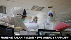 Iranian medical personnel, wearing protective gear, work at the quartine ward of a hospital in Tehran on March 1, 2020.