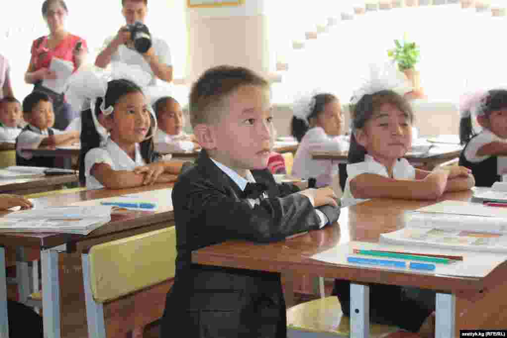 A first-grader begins his primary education at School No. 82 in the Ala-Too settlement outside of Bishkek, Kyrgyzstan.