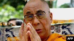 The exiled Tibetan leader, the Dalai Lama, will have to wait to meet with U.S. President Barack Obama in order to avoid upsetting China. But some say the United States should be more assertive in challenging China on its rights record.