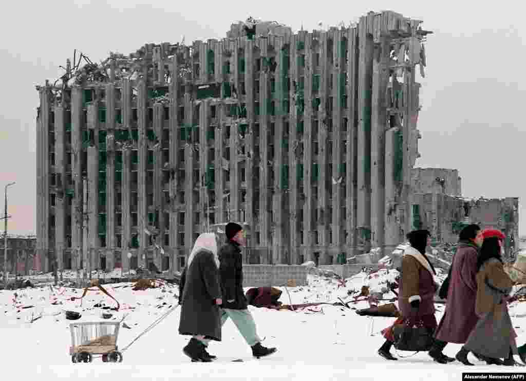 Chechen civilians in Grozny. The capital has become a ruin, reminiscent of the wrecked cities of Europe after World War II.