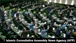 Iranian lawmakers chanting anti-U.S. slogans at the parliament in Tehran on May 9
