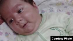 Пятимесячный младенец Умарали Назаров, который скончался в больнице Санкт-Петербурга после того, как его разлучили с матерью.