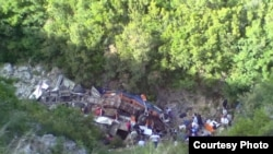 The bus, which was mostly carrying university students, fell off a cliff some 200 kilometers south of Tirana.