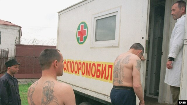 """Russian prisoners being examined for tuberculosis. Russian data on TB and other diseases only reports """"first-time"""" cases. Relapses, reoccurrences, and repeat infections are not included."""