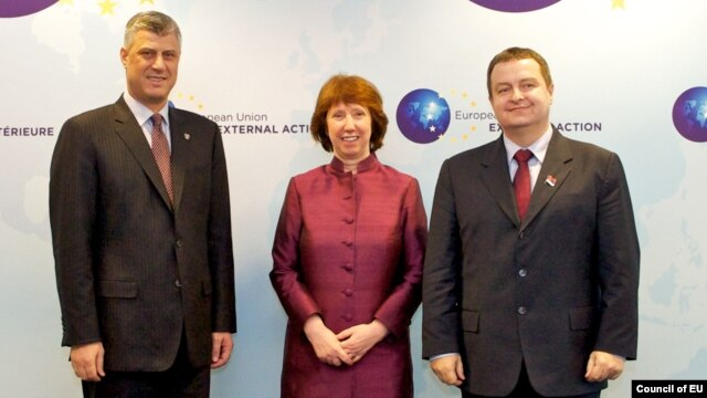 European Union foreign-policy chief Catherine Ashton met on February 19 with Kosovo's Hashim Thaci (left) and Serbia's Ivica Dacic (right).