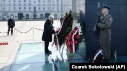 The head of the Polish Law and Justice party, Jaroslaw Kaczynski, lays a wreath at a monument to his late twin brother, former President Lech Kaczynski, on Pilsudski Square in Warsaw on April 10.
