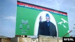 A large campaign poster for incumbent Afghan President Hamid Karzai