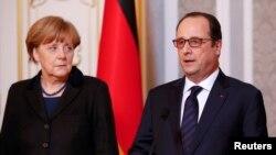 Канцлер Германии Ангела Меркель и президент Франции Франсуа Олланд. Минск, 12 февраля 2015 года.