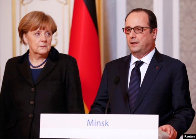 German Chancellor Angela Merkel (left) and French President Francois Hollande address the media after taking part in peace talks on resolving the Ukrainian crisis in Minsk on February 12, 2015.
