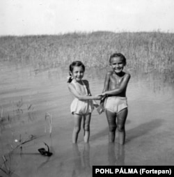 The Fortepan archive also holds precious moments of humanity far removed from the politics and conflict of the period. This snap captures two young besties in the shallows of Lake Balaton in 1954.