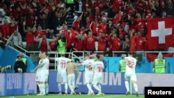 The Swiss soccer team celebrates in Kaliningrad, Russia, on June 22.