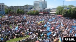 Crimean Tatars commemorate the 65th anniversary of the mass deportation in Simferopol on May 18.