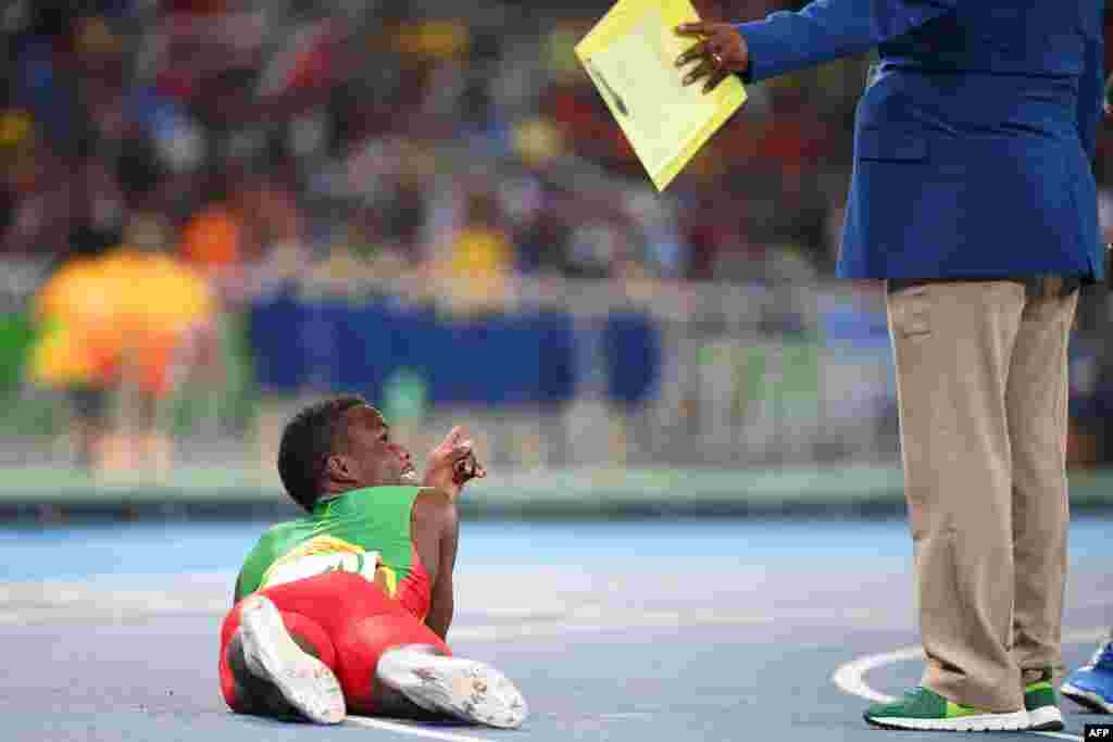 Grenada's Bralon Taplin reacts after competing in the men's 400-meter semifinal during the athletics event at the Olympic Stadium.