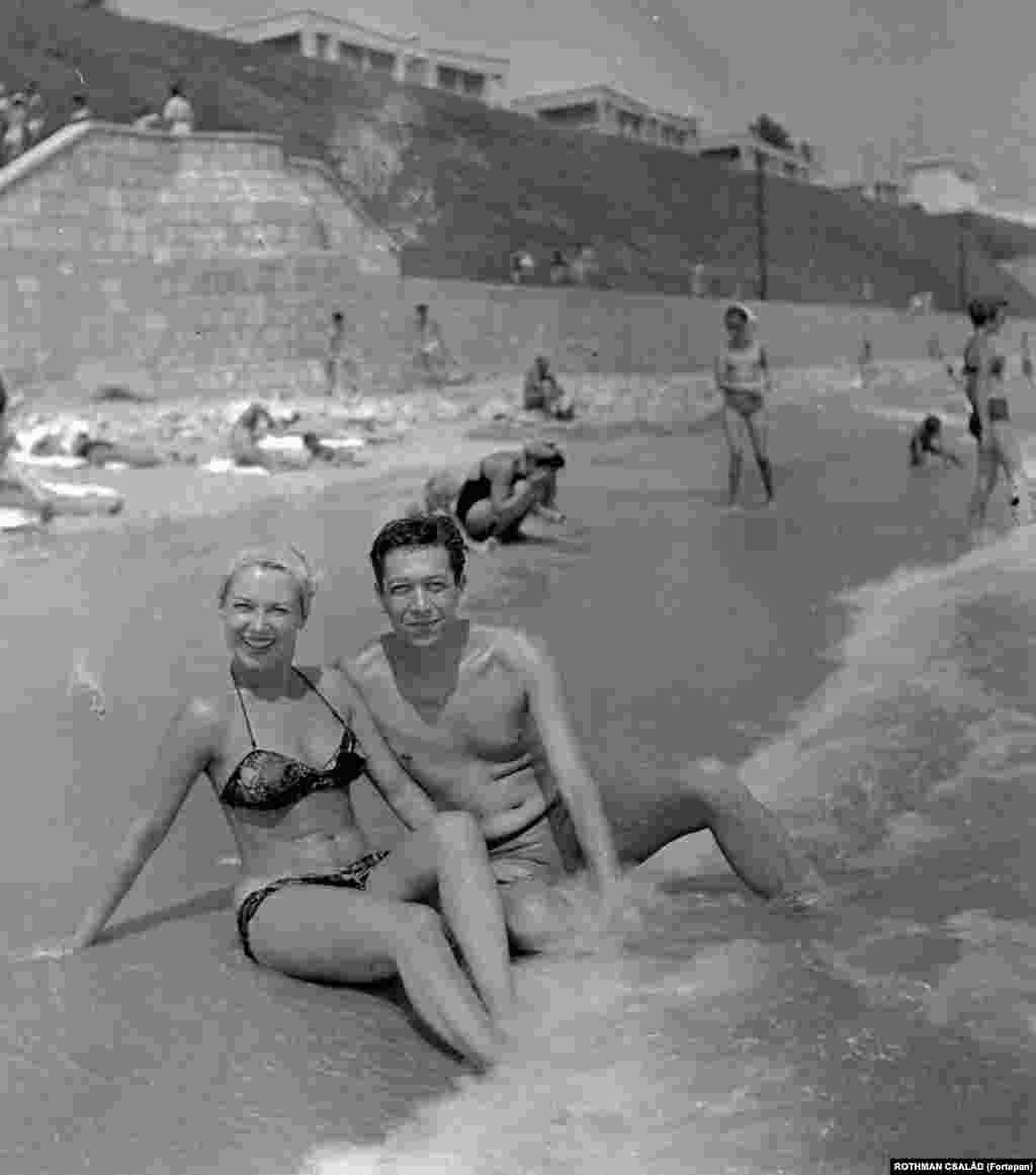 Actors Istvan Rozsos and Dorottya Geczi relax in the waves of the Black Sea near Constanta in 1959.