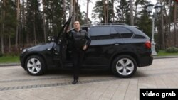 Russian Prime Minister Dmitry Medvedev steps out of a BMW SUV in a video posted on his blog. As one commentator noted, all it needed was a gangster-film soundtrack.