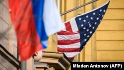 A Russian flag flies next to the U.S. Embassy in Moscow (file photo)