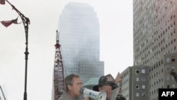 U.S. President George W. Bush speaks to firefighters at Ground Zero on September 14, 2001.