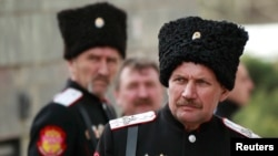 Cossacks stand guard near the Crimean parliament building in Simferopol in March 2014 as Russia was taking over the region from Ukraine.