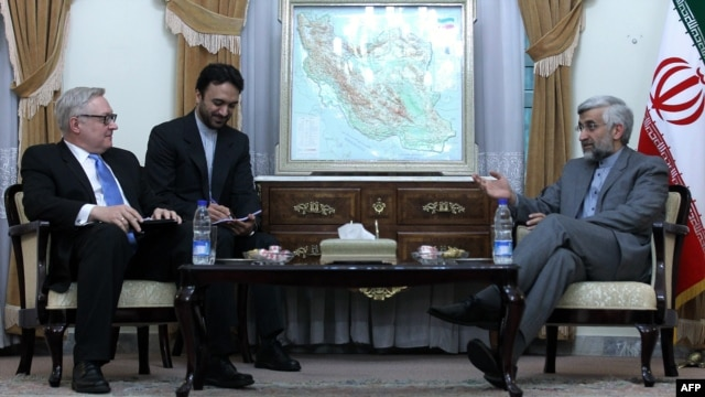 Top nuclear negotiator Saeed Jalili speaks with Sergei Ryabkov, Russia's representative in international talks with Iran, over its disputed nuclear program, during a meeting in Tehran on November 14.