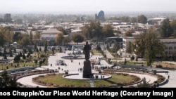 "A massive statue of Tamerlane, seen in 2007, towers over UNESCO-protected medieval quarters of Shahrisabz, Uzbekistan before they were bulldozed in a government ""tourism development"" project."