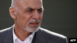 Afghan President Ashraf Ghani makes a brief statement to the news media before starting talks at Camp David in Camp David, Maryland, on March 23.