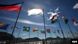 Flags of participating countries fly outside a TEDx summit in Rio de Janeiro in June.