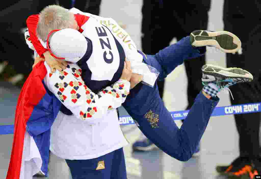 Silver medallist Martina Sablikova (right) of the Czech Republic celebrates with her coach Petr Novak after the women's 3000-meter speed-skating event in Adler Arena.