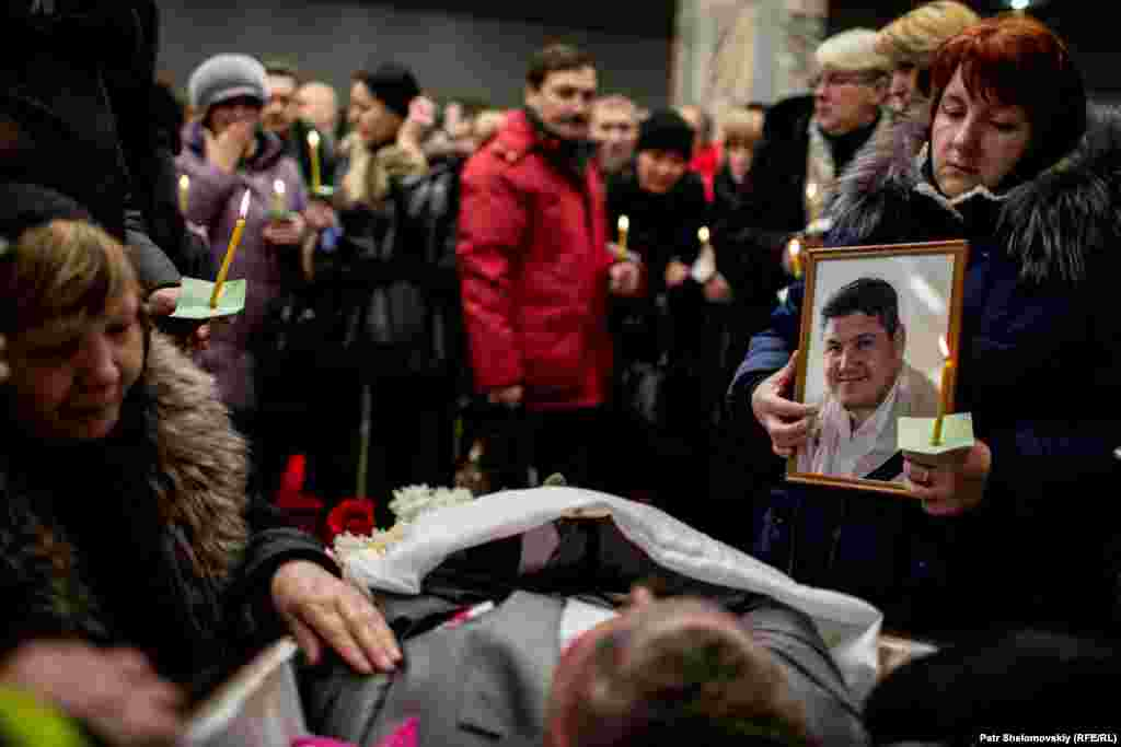 Mourners attend memorial services for five rescue workers and a miner killed in one of a series of mine explosions in Vorkuta.