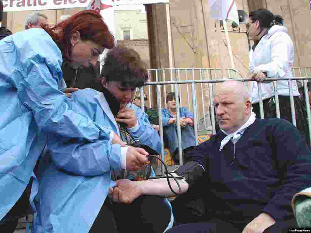 Georgia -- Parliamentarian Bidzina Gujabidze on a hunger strike outside the Parliament building in Tbilisi, 11Mar2008 - Lawmaker Bidzina Gujabidze, shown here undergoing a medical check, was among the Georgian hunger strikers. The strike ended after more than two weeks without winning any compromises from the ruling party.