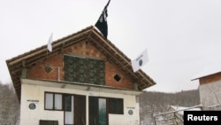 A house in the Bosnian village of Gornja Maoca decorated with Islamic State flags.