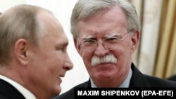 Russian President Vladimir Putin (left) meets with U.S. national-security adviser John Bolton in Moscow on October 23.
