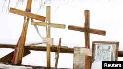Crosses are seen at the site of a 2010 plane crash that killed Poland's former President Lech Kaczynski and 95 others near Smolensk.