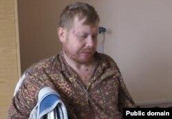 Володимир Жемчугов під час допиту у полоні бойовиків (скріншот сайту «Новостной фронт»)