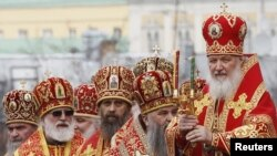 Patriarch Kirill (right) leads a call to prayer in support of the Russian Orthodox Church at Christ the Savior Cathedral in Moscow.