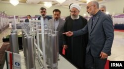 President Hassan Rouhani inspecting nuclear technology with the head of Iran's Atomic Energy Organization, as Iran marks National Nuclear Technology Day, April, 2019.