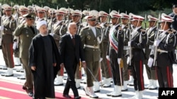 Iranian President Hassan Rohani (L) and visiting Afghan President Ashraf Ghani in Tehran on April 19.