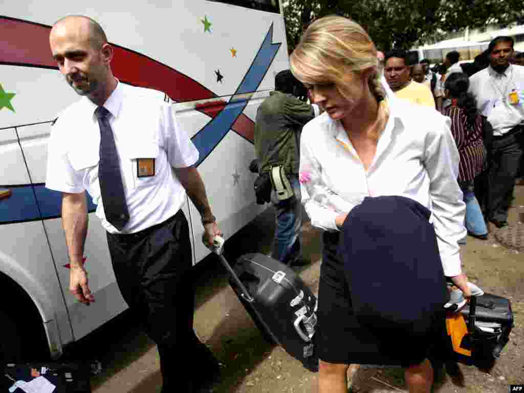 Flight attendants are released from the Trident Hotel in Mumbai on November 28.