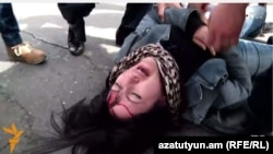 Armenia - Opposition protester Ruzanna Yegnukian is injured during a scuffle with riot police, Yerevan, 24March2016.