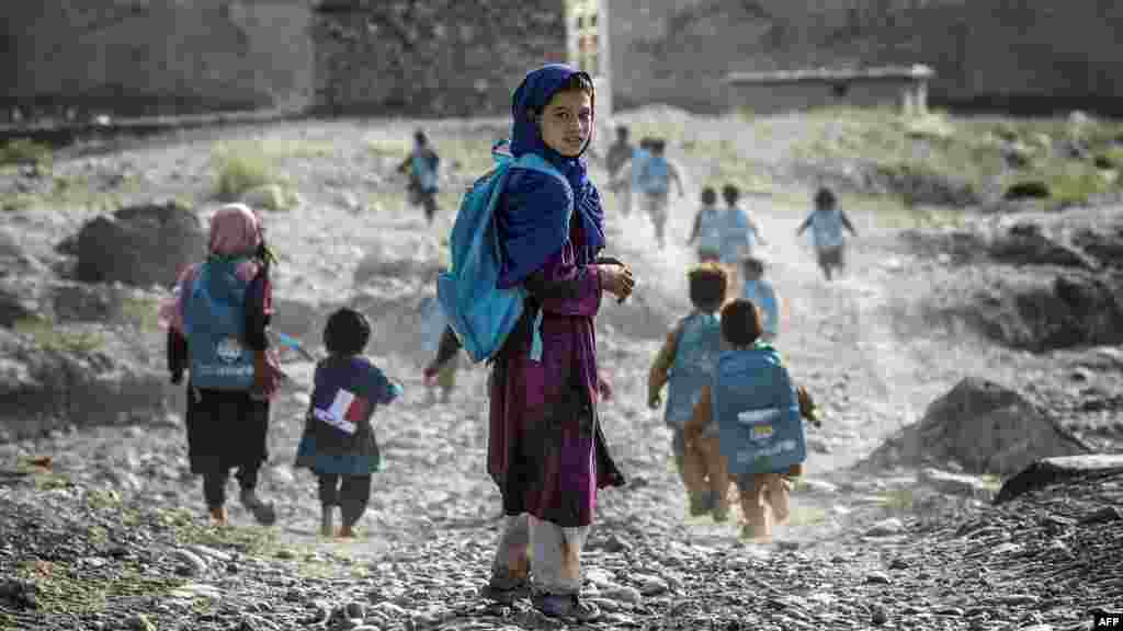 Afghan children on their way to school in a village on the road to Naghlu, which houses a French Army base, on September 24. (AFP/Jeff Pachoud)