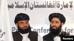FILE: Muhammad Naeem (R), a spokesman for the Taliban office in Qatar speaks in Doha, June 2013.