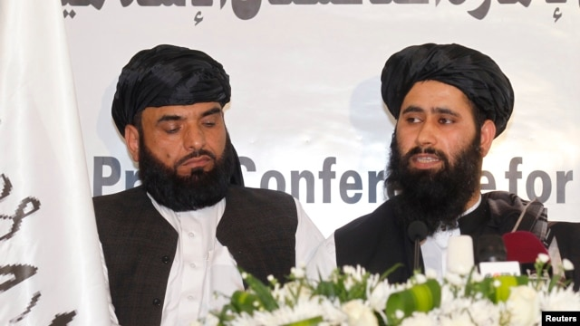 Muhammad Naeem (right), a spokesman for the Office of the Taliban of Afghanistan, speaks during the opening of the Taliban Afghanistan Political Office in Doha, Qatar, on June 18.